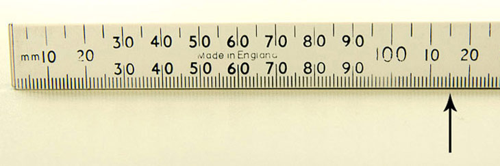 Photo A Four Fold Ruler With An Arrow Pointing To Fifth Division After The 100 And
